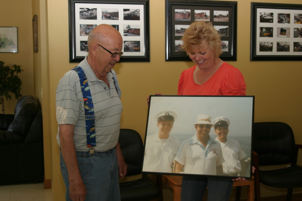 Jennifer Redfearn and her father, Jack Graves, look at a picture of the boys from their Navy Tiger Cruise.
