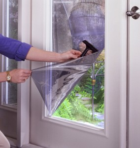Energy-saving window film is installed on clean wet glass using a squeegee to eliminate bubbles.