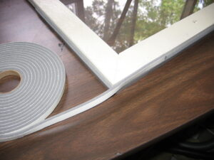 To install do-it-yourself storm windows, attach foam weatherstripping around the frame to seal against the ­window opening and to hold it in place.
