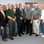 The Spoon River Electric Cooperative Board of Directors congratulates State Rep. Mike Unes (R-East Peoria), who was awarded the Illinois Electric Cooperatives' Public Service Award. Pictured in the front row (left to right) are Director John Spangler, Director Greg Leigh, Rep. Mike Unes, President/CEO Bill Dodds, Board Chairman Jack Clark and Director Lyle Nelson. In the back row (left to right) are Directors Bob Lascelles, Terry Beam, Steve Pille, Jim Banks and Bernard Marvel.