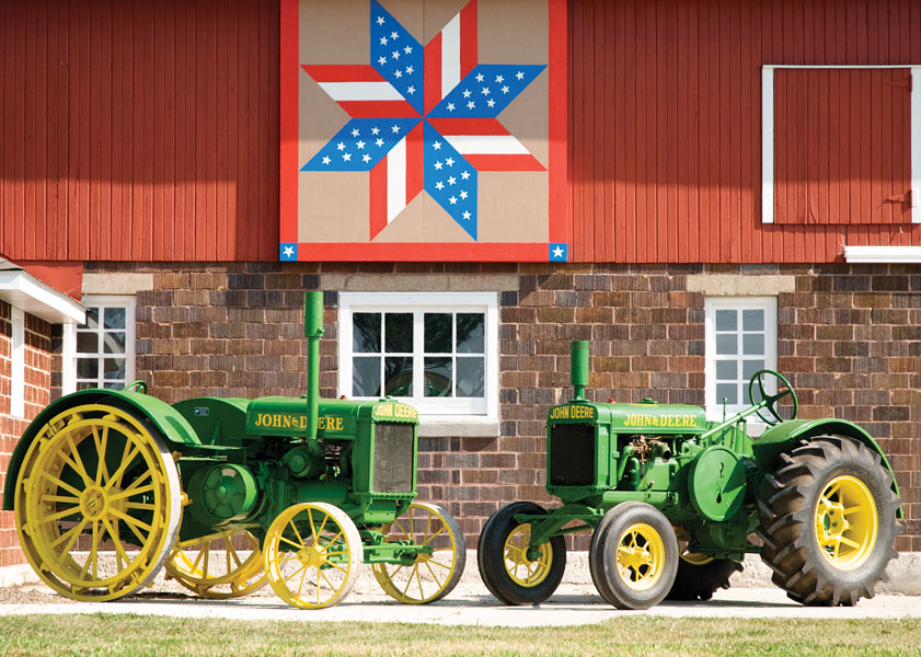 Patriotic pattern on the Rodney Schwark barn with two of his antique tractors