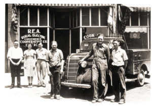 Rural Electric Convenience Cooperative's first office was located in downtown Divernon and remained there until 1954. Some of the co-op's first employees gathered for this photo. From left are Charles Masters, project superintendent, Elizabeth Roncz, secretary, Manford White, bookkeeper, Virgil Brown, lineman, Bud Wilson, foreman and Eric Dossett, lineman.