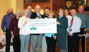 Shown at the Savanna Museum and Cultural Center GeoAlliance geothermal check presentation from left, front row, are: Heidi Weber, Jo-Carroll Energy Manager of Member Relations and Marketing; John LeComte, Savanna Historical Society (SHS) Board Member; Jeannine Mills, SHS Board Member; Nancy McDonald, Association of Illinois Electric Cooperatives Marketing Administrator; and Larry Stebbins, Mayor of Savanna. Pictured from left, back row are: John Scott, Jo-Carroll Energy, Inc. Energy Advisor; Jean Jones, SHS Treasurer; State Senator Mike Jacobs; Gene Wright, SHS Board Member; Carol Wright, SHS Board Member; and Keith Brown, SHS Vice-President.