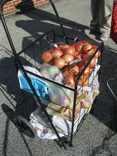 Families in need of food assistance receive fresh produce items.