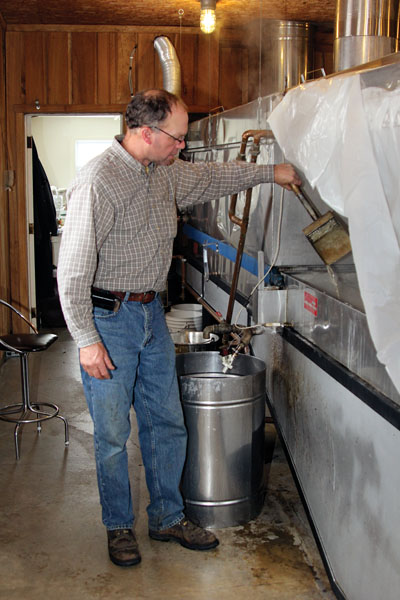 Mike Funk checks the sap for sugar sand.