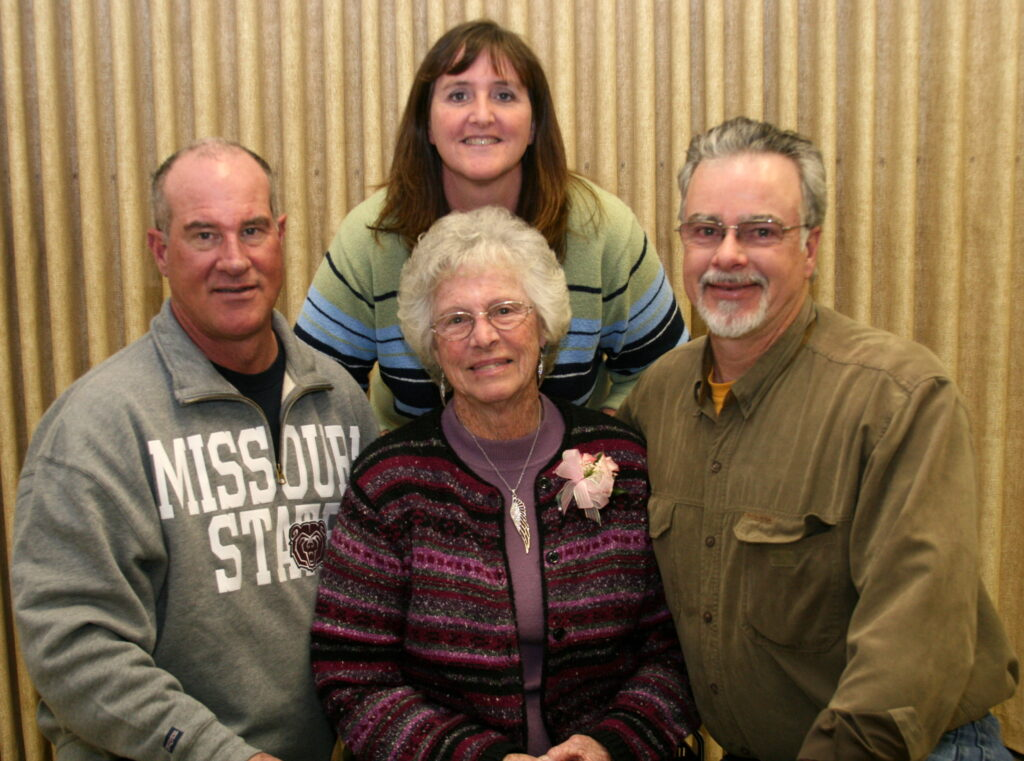 JoAn, center, with her children (l-r) Michael, Linda and Mark.