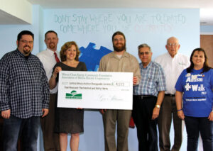 Pictured from left are: Calvary Baptist Church Pastor Michael Loy,  Coles-Moultrie Electric Cooperative Marketing Services Specialist Sam Adair, AIEC Marketing Administrator Nancy Rhoads McDonald; CIATS Board President Dustin Brown; City of Charleston Mayor-Elect Larry Rennels, Basham Electric Owner Dick Basham and CIATS Founder and Executive Director Vivian Skelley.