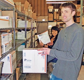 Phoenix Leather Goods warehouse team members Grace Lezondra and Ron Forsberg pack products for shipment by using free Priority Mail envelopes and boxes.