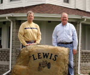 Brothers Charles (l) and Walt Lewis in front of the 1907 home where Walt and his family live.