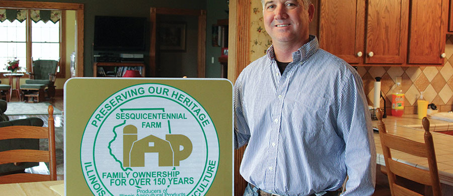 Randy Mead of rural Dongola with his Sesquicentennial Farm sign.