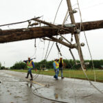 Western Farmers Electric Cooperative contractor crews work on damaged areas in the Moore, Okla.