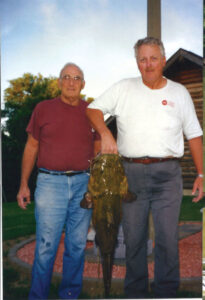 Bob and Cal Williams after a day of hoggin'.