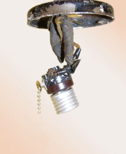 This improperly wired overhead lamp switch reveals a potential home danger. Electrical code requires wire nuts for connections, but these ­connections have been taped. The wires could become exposed and touch the lamp's metal base, resulting in electrical shock.  Source: Underwriters Laboratories