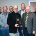 State Senator Dave Koehler (D- Peoria, 46th District) was presented with the 2013 Illinois Electric Cooperatives' Public Service Award by Spoon River Electric Cooperative President/CEO William R. Dodds (right). Also congratulating Sen. Koehler November 25 at the presentation were Spoon River Electric board members (back row left - right) Bernard Marvel, Lyle H. Nelson, James C. Banks, Bob D. Lascelles, Gregory M. Leigh, Steve M. Pille, Jack L. Clark and Terry A. Beam.