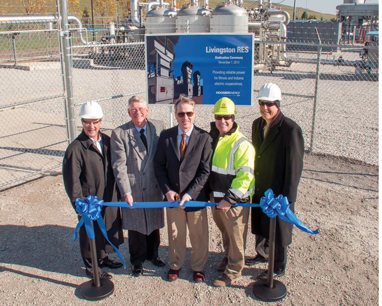 From the left, Association of Illinois Electric Cooperatives President/CEO Duane Noland, Hoosier Energy Board Chairman Jim Weimer, Hoosier Energy President/CEO Steve Smith, Republic Services Environmental Manager Eric Dippon, and AIEC Sr. Vice President of Government Relations Don Wood cut the ribbon to the new 154 MW methane gas generating facility near Pontiac.