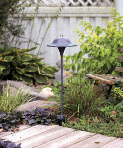 A tall die cast metal landscaping light brightens a large area to double as a ­security light. The large diameter top ­limits light pollution of the night sky. Source: Hadco