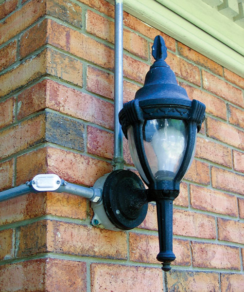 When installing outdoor security/  entertainment lighting, always follow local electric codes. This installation uses rigid aluminum conduit. Source: James Dulley