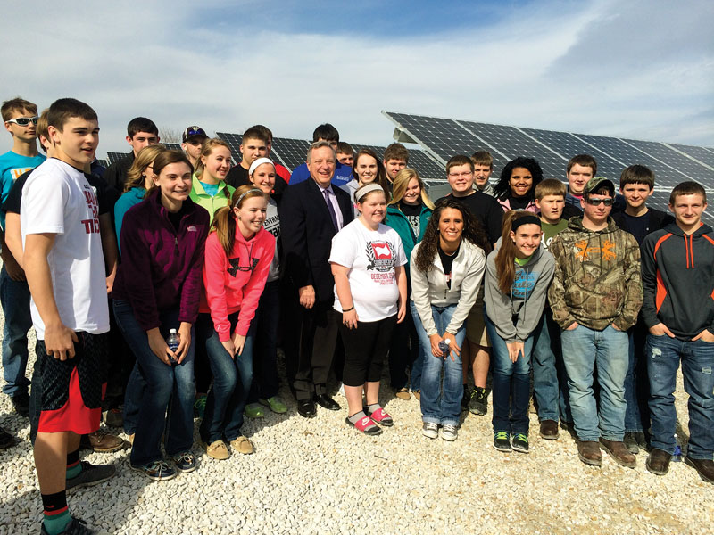 Pictured here with U.S. Sen. Dick Durbin, science ­students from Winchester High School were in ­attendance for the ­ribbon-cutting. The high school and IL Rural plan to collaborate to use the facility as an educational tool.