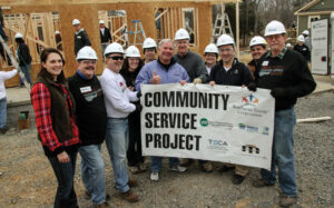 Community service volunteers included Kevin Bernson, Vice President of Media and Public Relations at Shelby Electric Cooperative (third from left) and Aaron Ridenour, Manager of Marketing & Business Development at Prairie Power, Inc. (on far right).