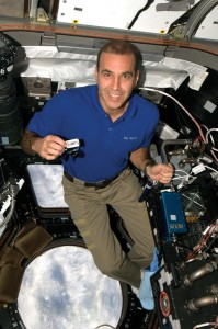 Rick in space with Travel Bug.courtesy.geocaching.com copy
