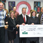 Presenting a $50,000 grant check at the Ball-Chatham School Board meeting, from right are David Stuva, President/CEO of Rural Electric Convenience Cooperative, and Nancy McDonald, Marketing Administrator for Association of Illinois Electric Cooperatives. Accepting the grant are Board President Rick Petermeyer, Superintendent Carrie Hruby, and Nate Fretz, Chief School Business Official.