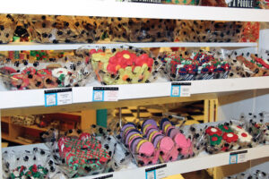 The pet treat case at Millie and Bo's Barkery looks like a display at your local bakery. These treats are coated with colorful yogurt or carob melt decorations.