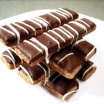 PupDog Bakery has a very popular peanut butter bar coated in carob with a yogurt drizzle.