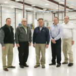 Soon this factory floor at IHI Turbo America in Shelbyville will have new equipment and 30 new employees making turbochargers for Audi. Inspecting the new addition are Josh Shallenberger, COO Shelby Electric Cooperative; John Schuessler, General Manager IHI Turbo America; James Coleman, President/CEO Shelby Electric; Mike Price, Controller IHI Turbo; and Aaron Ridenour, Marketing & Business Development Prairie Power, Inc.