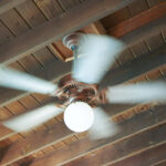 You can lower your AC thermostat and stay comfortable with a ceiling paddle fan.