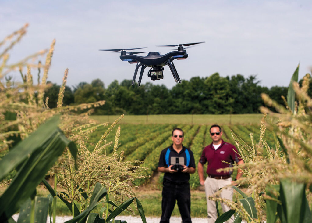 Dennis Watson, left, and Chris Clemons, faculty members in the Department of Agricultural Systems and Education at Southern Illinois University Carbondale, test fly a 3D Robotics Solo unmanned aerial vehicle, popularly known as a drone. The university is adding a component on agricultural drones to its curriculum. (Photo by Russell Bailey)