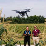 Dennis Watson, left, and Chris Clemons, faculty members in the Department of Agricultural Systems and Education at Southern Illinois University Carbondale, test fly a 3D Robotics Solo unmanned aerial vehicle, popularly known as a drone. The university is adding a ­component on agricul­tural drones to its curriculum. (Photo by Russell Bailey)