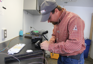 Prairie Power, Inc. Substation Foreman and Primary Fiber Splicer Ryan Ruppel enjoys his new job, but says it requires precision and patience. The fiber is hair thin, incredibly strong and very brittle if you bend it.