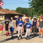 Stephens picks up a small parade as he walks through a town in support of  WWP.