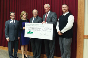 Pictured from left are: Josh Bullock, Lake Land College President, Nancy McDonald, Marketing Administrator, AIEC; Gary Cadwell, Lake Land College Board Chairman; Kim Leftwich, President and CEO, Coles-Moultrie Electric Cooperative; and Sam Adair, Member Services Representative, Coles-Moultrie Electric Cooperative.