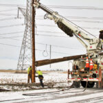 Ice, wind and flood waters hit two Illinois electric cooperatives just after Christmas, ­leaving some members without power for several days. But co-op linemen from across the state came to aid Corn Belt Energy crews replace more than 100 broken poles. Record rainfall in late December also caused massive problems for rural areas across the state.