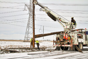 Ice, wind and flood waters hit two Illinois electric cooperatives just after Christmas, leaving some members without power for several days. But co-op linemen from across the state came to aid Corn Belt Energy crews replace more than 100 broken poles. Record rainfall in late December also caused massive problems for rural areas across the state.