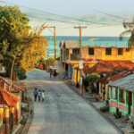 Haiti-street-scene-along-shore-with-new-electric-lines.jpeg