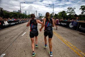 Guide Caroline Gaynor (left) and Ashley Eisenmenger complete the Life Time Chicago Triathlon. Photo courtesy of Life Time Chicago Triathlon and Ali Engin Photography.