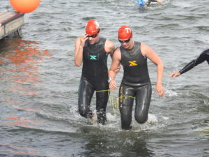 Ashley (left) and guide Lindsey Cook leave the water after the swimming leg of the race.