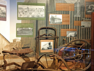 Farming exhibit with photos and antique farm implements