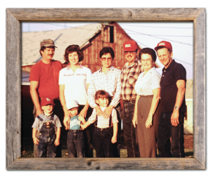 Phil Carson family photo from the early 1980s with a red barn in the background