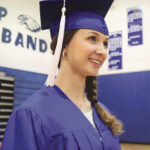 Girl in Cap ad Gown Graduating