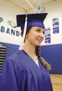 Girl in Cap ad Gown Graduating