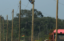 Lineman up on electric pole