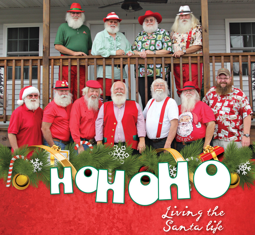 11 men dressed as Santa Claus pose for a photo.