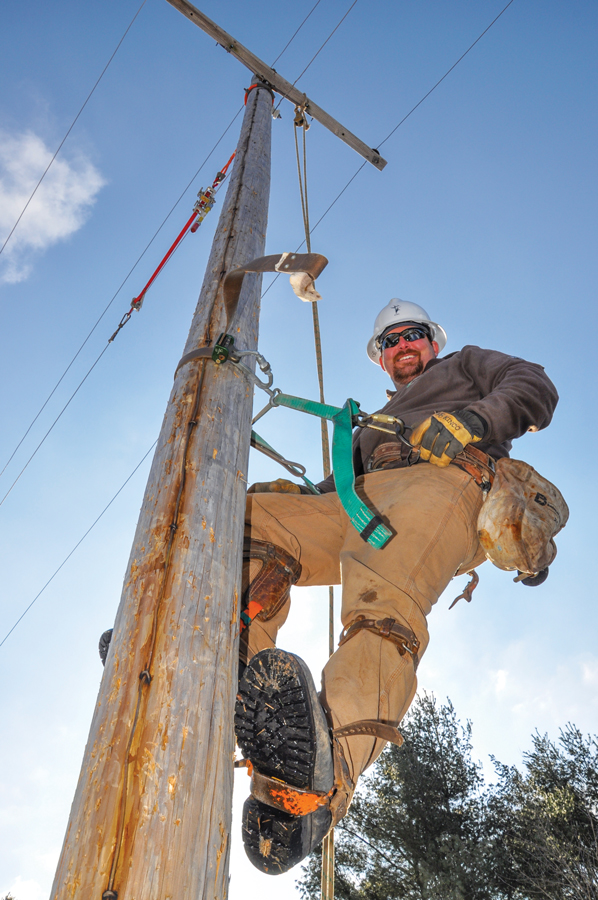 Lineworker On Pole