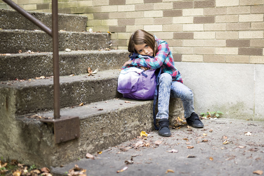 Sad-Girl-with-Backpack