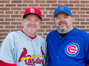 Brothers wearing cards and cubs apparel